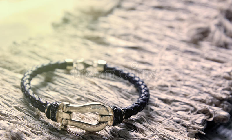 Gold and leather bracelet royalty free stock image