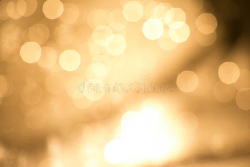 Gold light bokeh bakground royalty free stock image