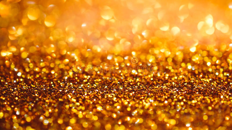 Gold light bokeh texture or glitter lights festive gold background. Christmas abstract template.  stock photography