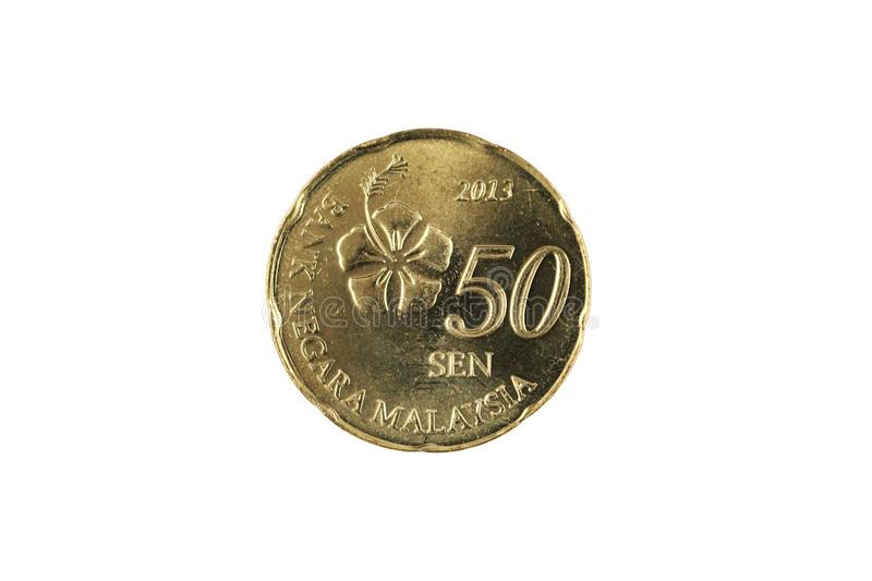 A gold Malaysian fifty sen coin isolated on a white background stock images