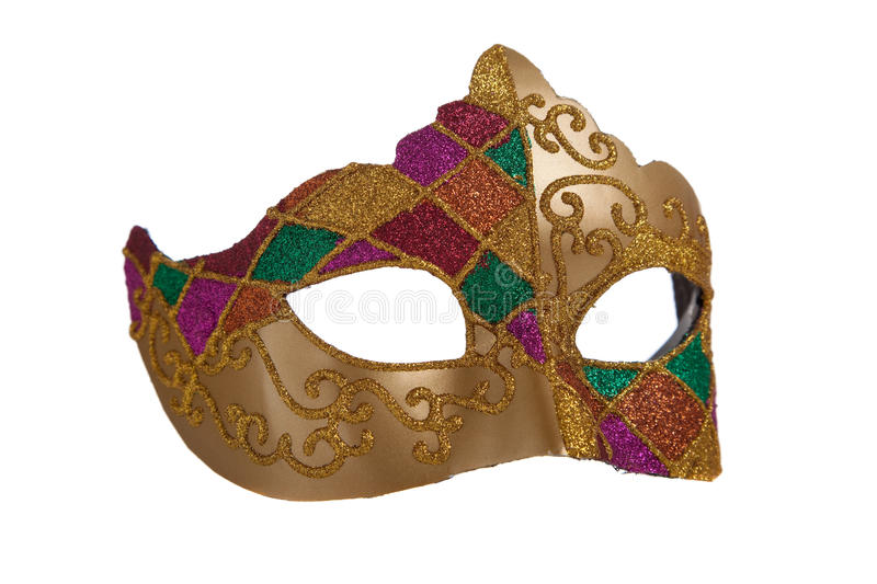 Gold mardi gra mask. A gold mardi gra mask with green and purple beads on a white background stock image