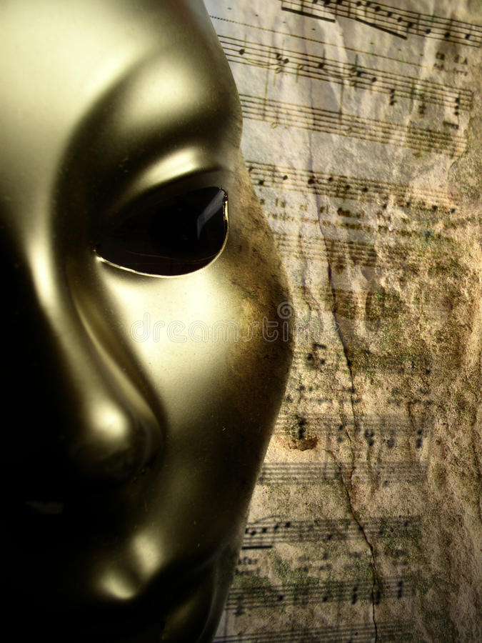 Gold mask music background stock photos