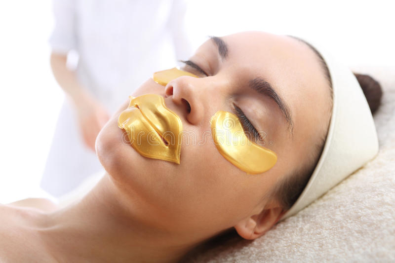 Gold mask, skin care around the eyes and mouth, stock photo