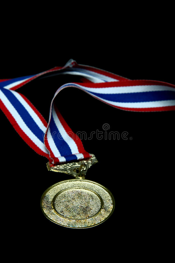 Gold medal. Isolated Blank gold medal with tricolor ribbon royalty free stock photos