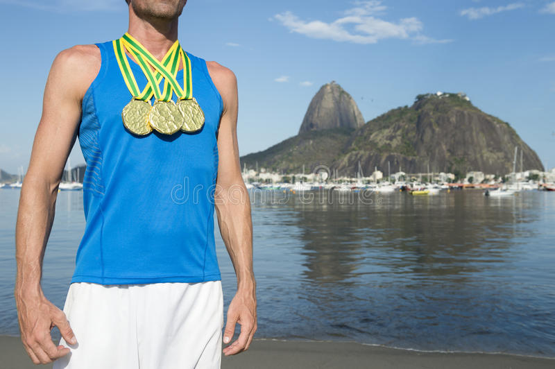 Gold Medal Athlete Standing at Botafogo Beach Rio. Frst place athlete wearing gold medals standing outdoors at Botafogo Bay Rio de Janeiro Brazil stock photo