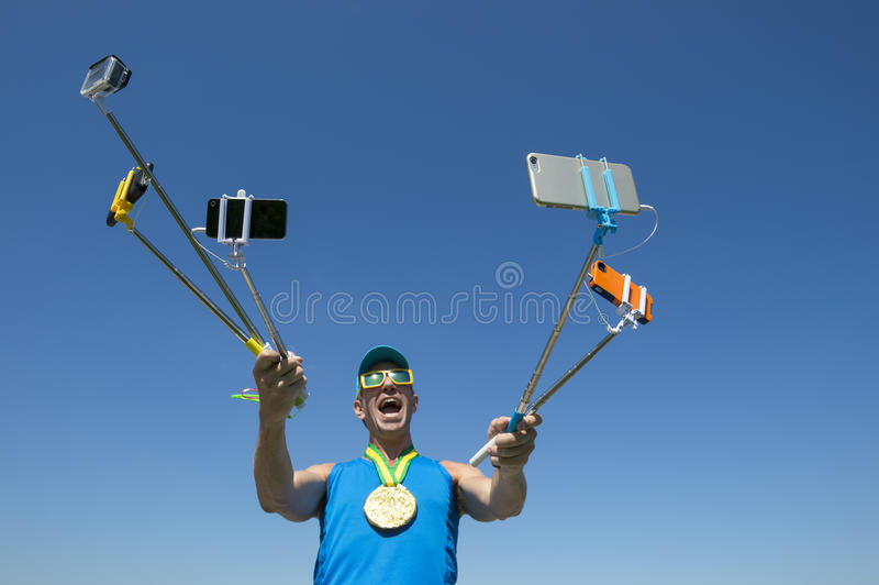 Gold Medal Athlete Taking Selfies with Selfie Sticks royalty free stock photos