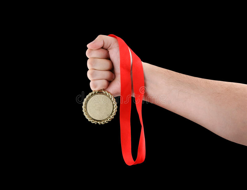 Gold Medal In Hand Isolated Royalty Free Stock Photography