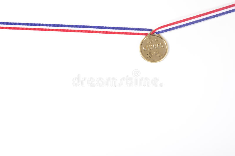 Gold medal on a ribbon isolated on white stock images