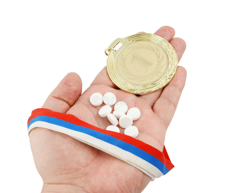Gold Medal And Tablets On Hand Stock Image