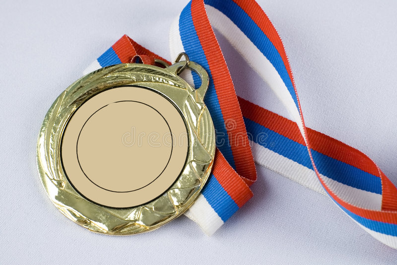 Gold medal with tricolor ribbon. The gold medal with tricolor ribbon royalty free stock photo