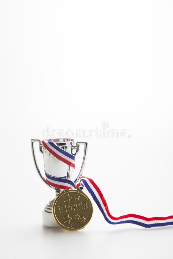 Gold medal winner with trophy stock photography