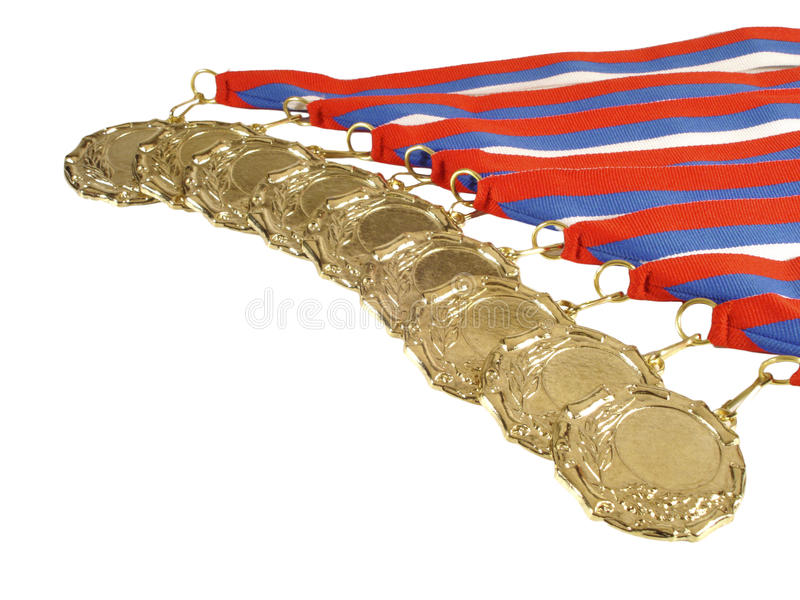 Gold medals with ribbons. On a white background stock photography