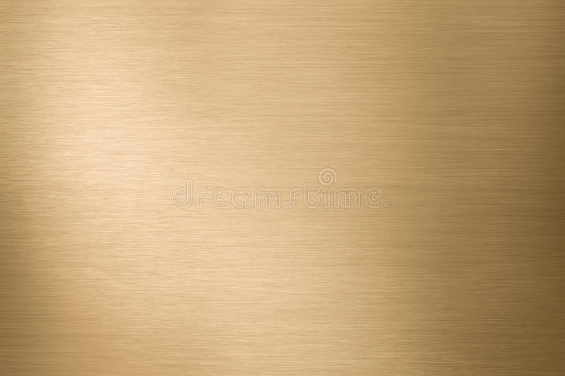Gold metal background. Gold brushed metal texture or background royalty free stock images