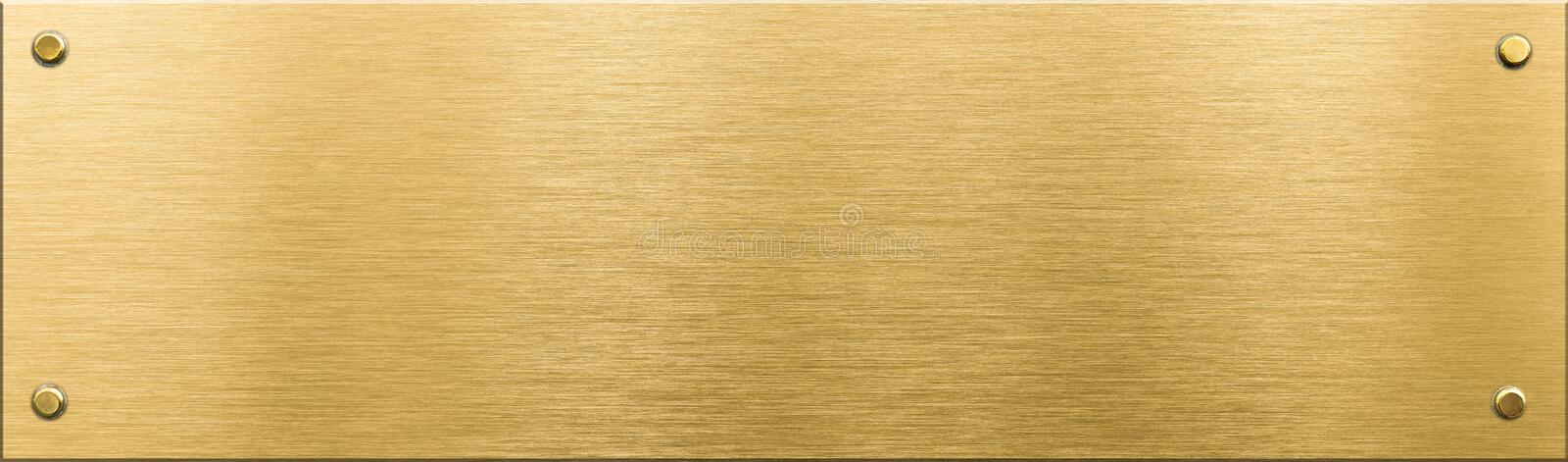 Gold metal plaque or nameboard with rivets royalty free stock photography