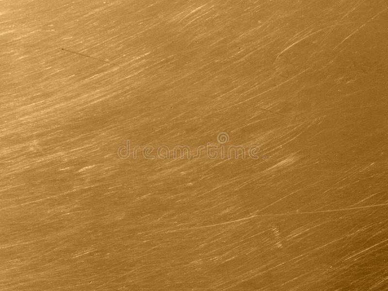 Gold metal texture with circular scratches. The gold metal texture with circular scratches royalty free stock photography