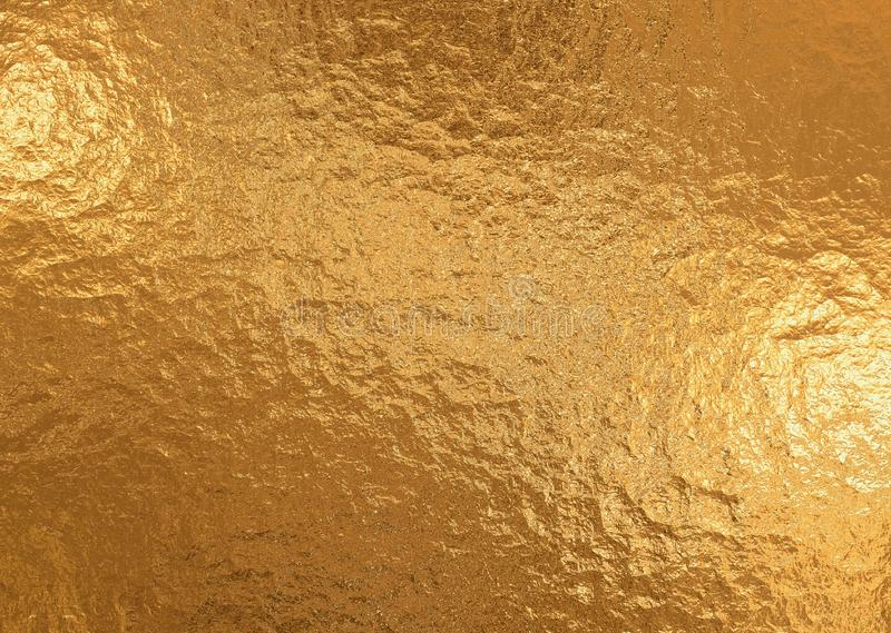 Gold metallic background, linen texture, bright festive background stock images
