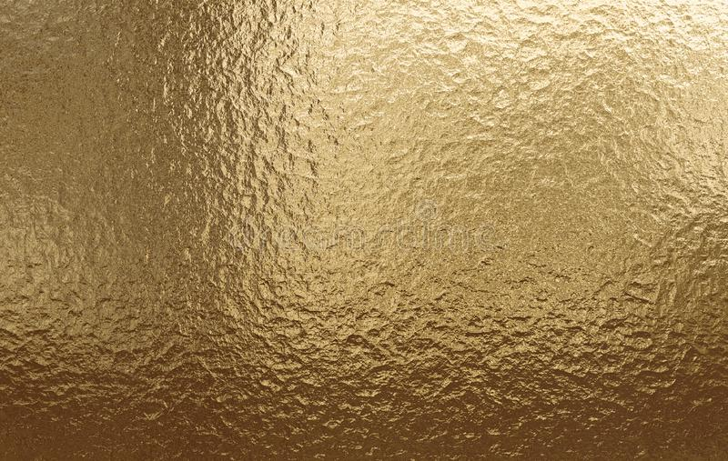 Gold metallic background, linen texture, bright festive background royalty free stock image