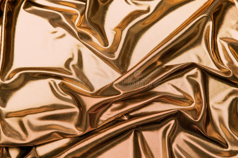 Gold metallic fabric. Ideal for a background stock photo