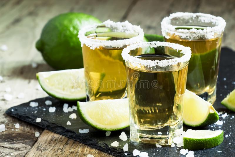 Gold Mexican tequila with lime and salt, selective focus stock photos