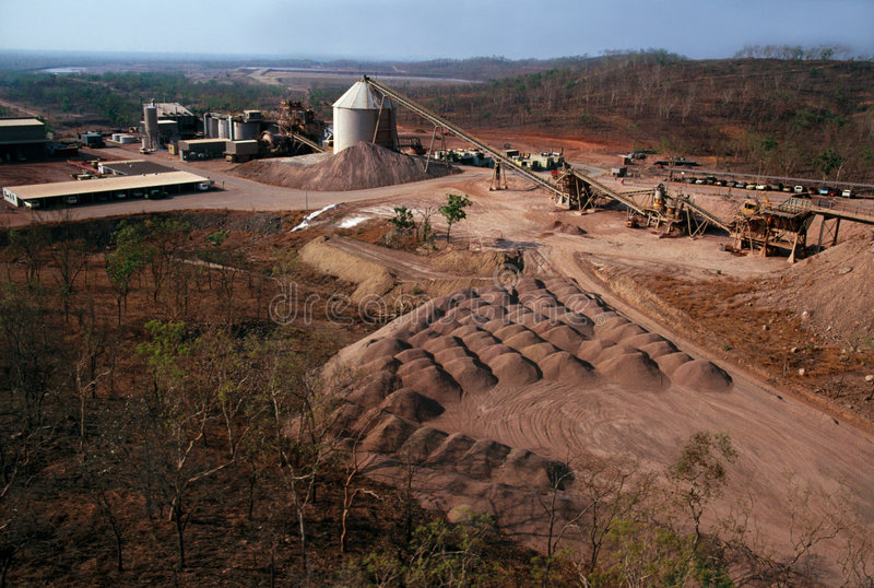 Gold Mine. View of Gold mine processing plant, with ore stock piles in foreground royalty free stock images
