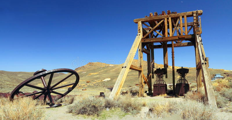 Bodie State Historic Site, California, USA - Gold Mining Equipment in Desert at Bodie Ghost Town, Mono County. Scattered gold mining equipment remains on the stock photo