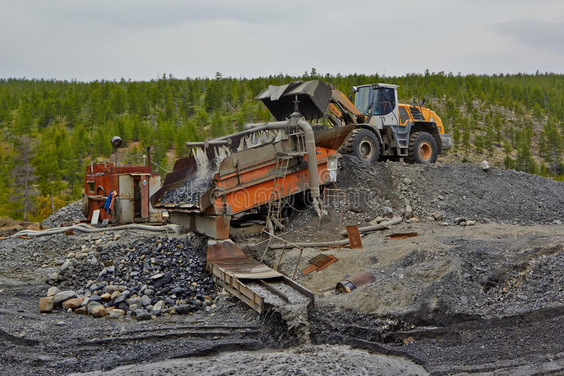 Download Gold Mining In Susuman. An Auto-loader And De-rocker Stock Image - Image: 62568731