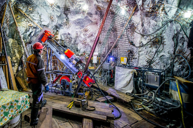 Gold mining underground. Digging though the tunnel stock image