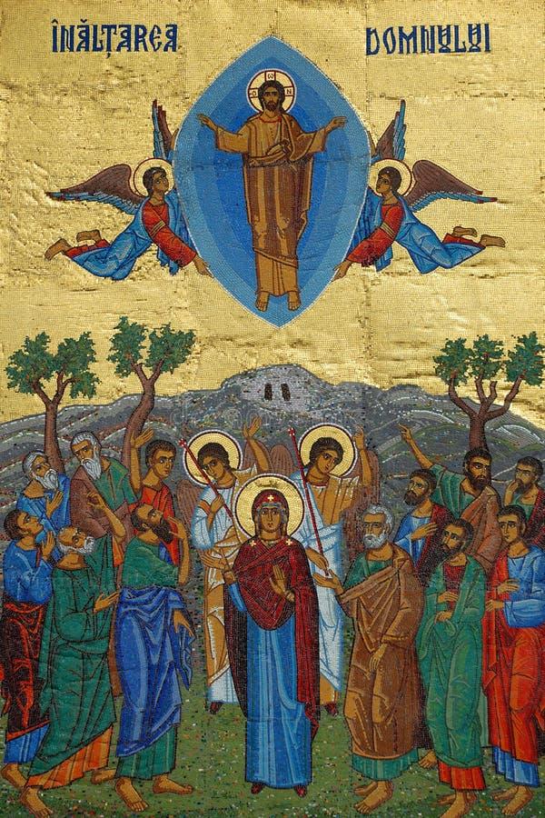 Gold mosaic of Jesus ascension scene stock photos