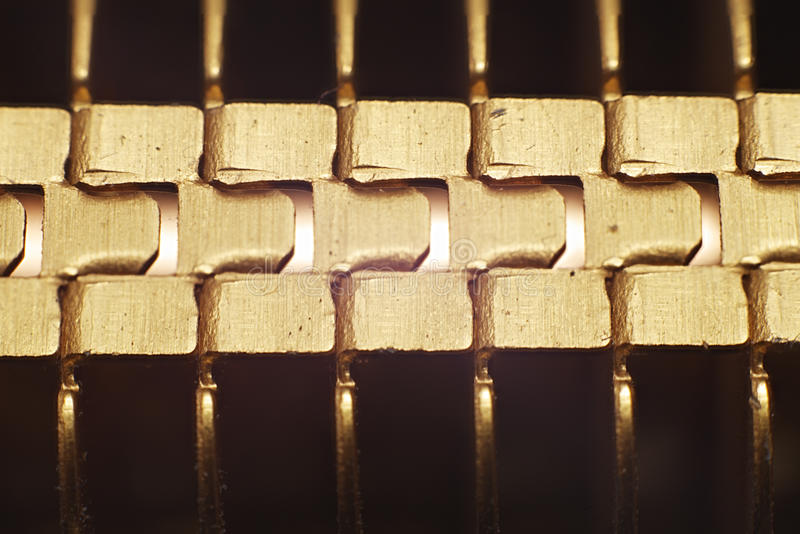Gold motherboard cooler. Macro shot of gold motherboard cooler stock image
