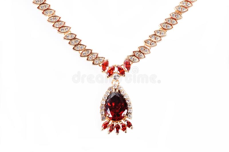 Gold necklace with red crystals on a white background stock photo download gold necklace with red crystals on a white background stock photo image of aloadofball Gallery
