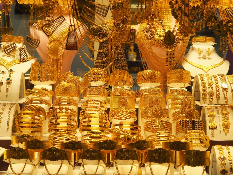 Gold necklaces, bracelets and various jewelery sold in a jewelery store at turkey. stock photo
