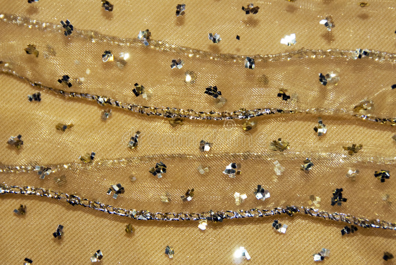 Gold netting fabric decor. Gold netting fabric used for holiday decor with little stars stock photos