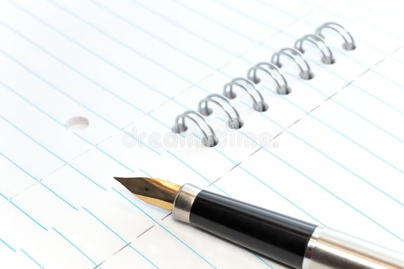 Download A Gold-nibbed Pen On A Notepad Stock Photo - Image of document, draw: 8545208