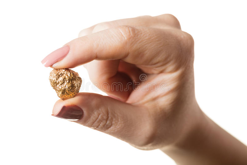 Gold nugget in hand royalty free stock image