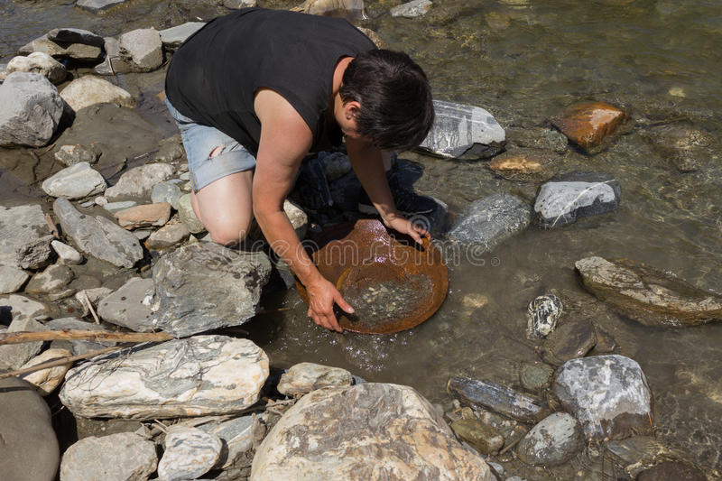 Gold Nugget mining from the River royalty free stock image
