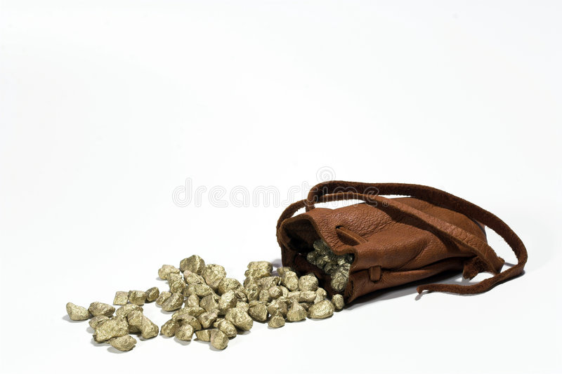 Gold Nuggets. Spilling from a leather pouch. Riches. Wealth stock images