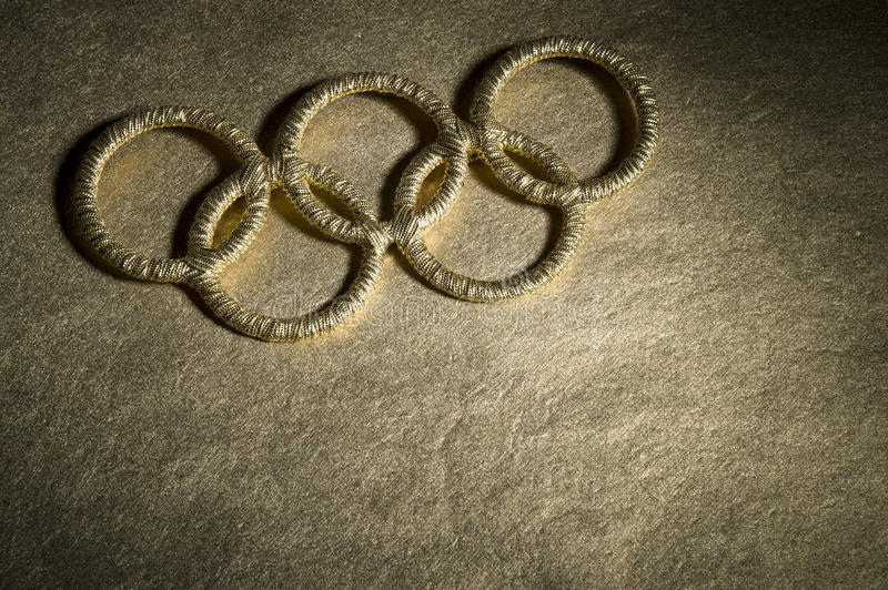 Gold Olympic Rings Symbol Under Spotlight royalty free stock photography