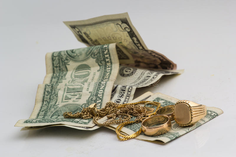 Gold ornaments and dollars royalty free stock images