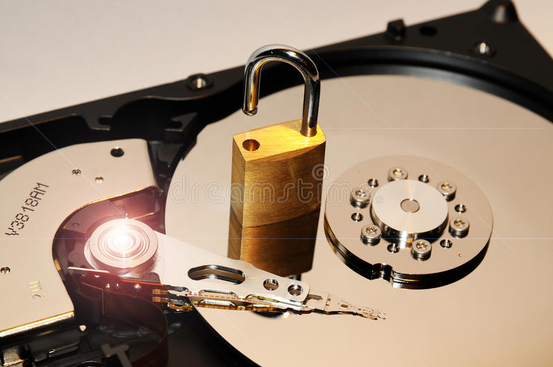 Gold padlock on the opened HDD disk drive surface. Data protection or security concept. Security background royalty free stock images