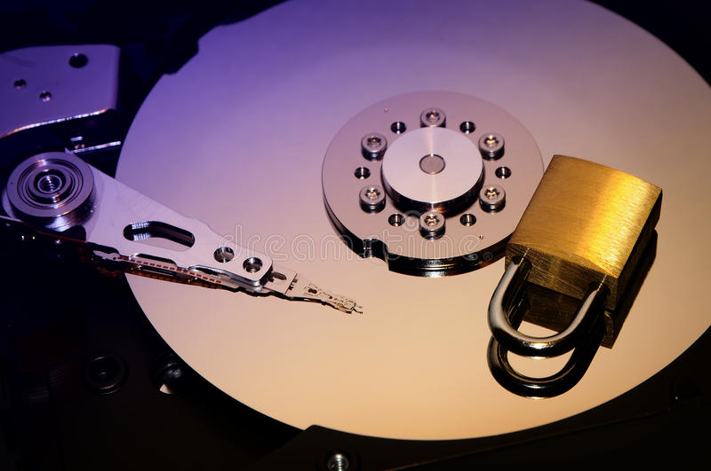 Gold padlock on the opened HDD disk drive surface. Data protection or security concept. Security background royalty free stock photo
