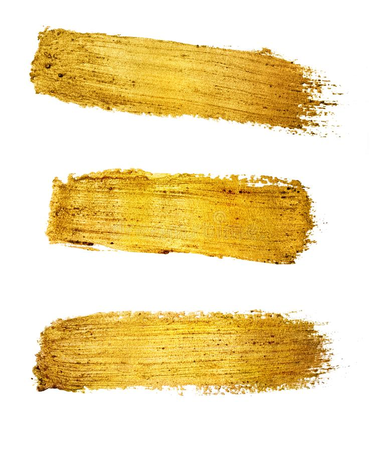 Gold paint brush stroke isolated on white stock image