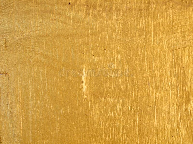 Gold paint on texture wood. Close up royalty free stock photo