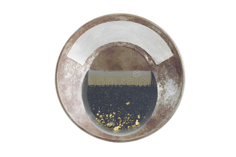 Gold pan with natural placer gold. Natural placer gold and nuggets in an old gold pan stock photography