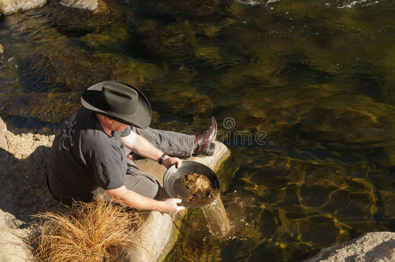 Gold panning royalty free stock images