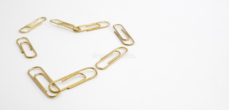 Gold Paper Clip Heart. Shape stock photo