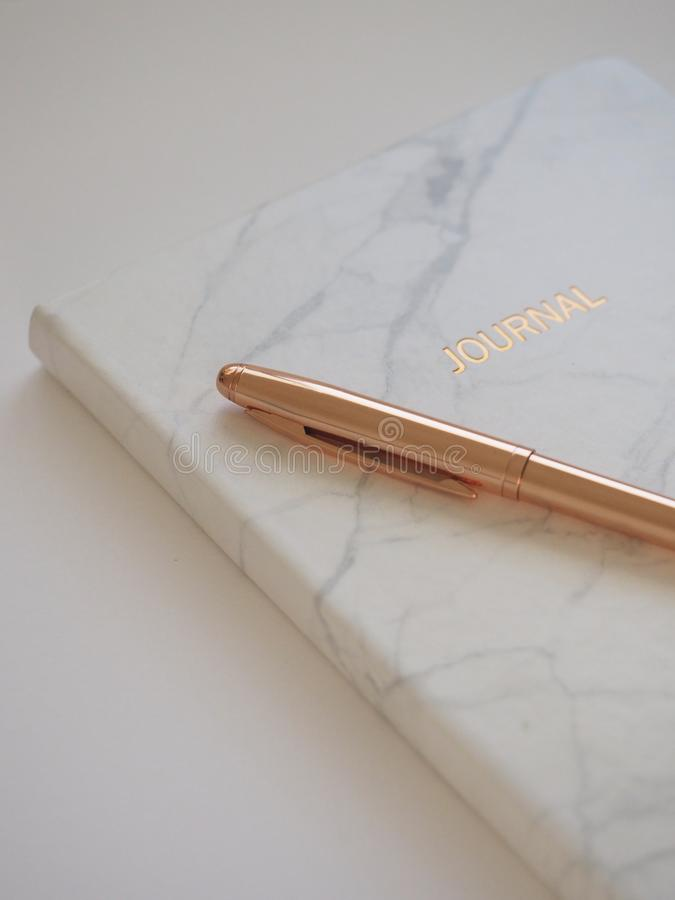 Gold Pen on Journal Book stock images