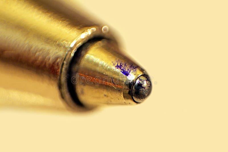 Gold pen nib. Macro photo of a gold pen nib showing ink splashes on ball stock images