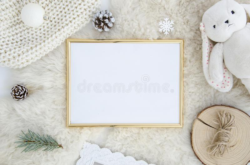 Gold Photo frame mock up with space for text, art work,lettering, pine cone fir branch,rope,rabbit toy on fur background stock photography