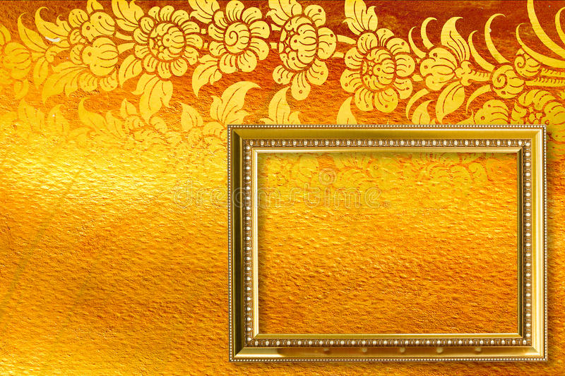 Gold picture frame. Gold picture frame on the golden thai pattern stock photo