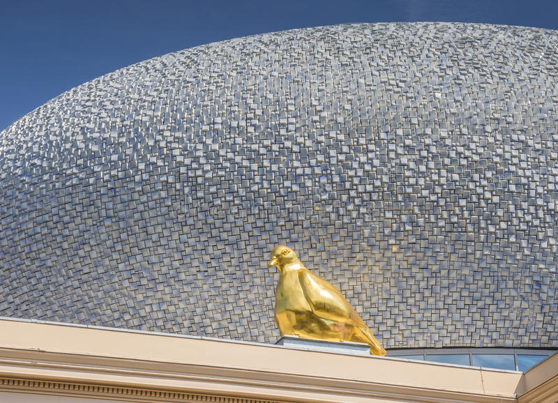 Gold pigeon on the roof of Museum De Fundatie in Zwolle. Holland stock photo
